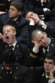 Naval Academy midshipmen sleep in their seats as they wait for President George Bush.